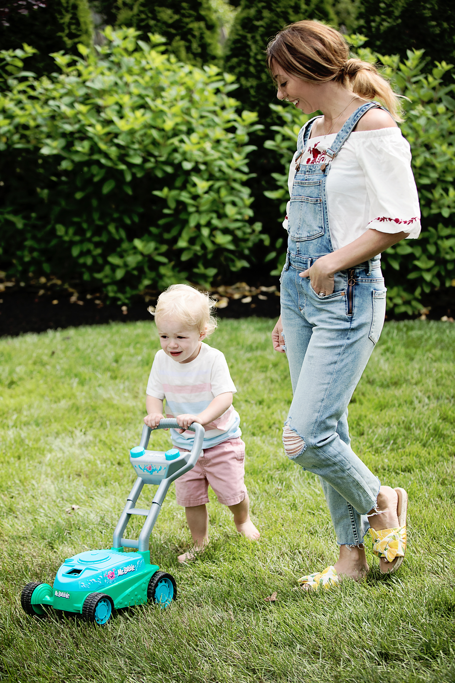 The motherchic wearing overalls