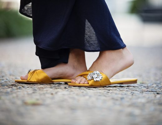 The motherchic wearing marc fisher flats to a wedding