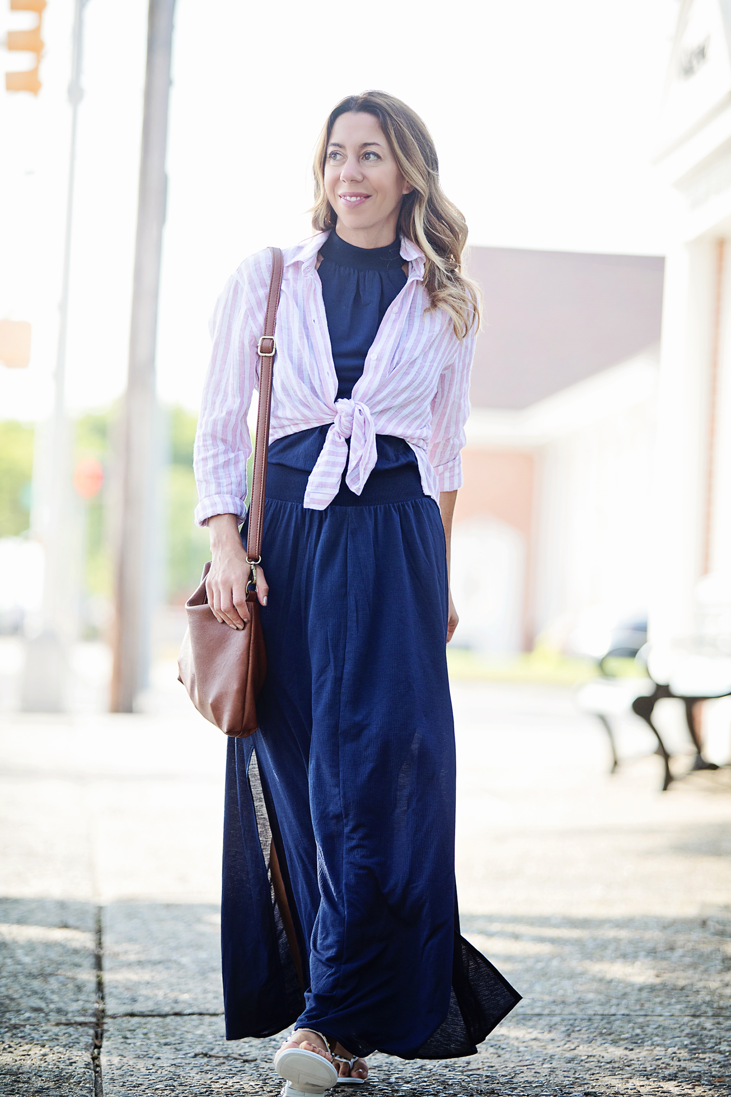 The Motherchic wearing rails button down