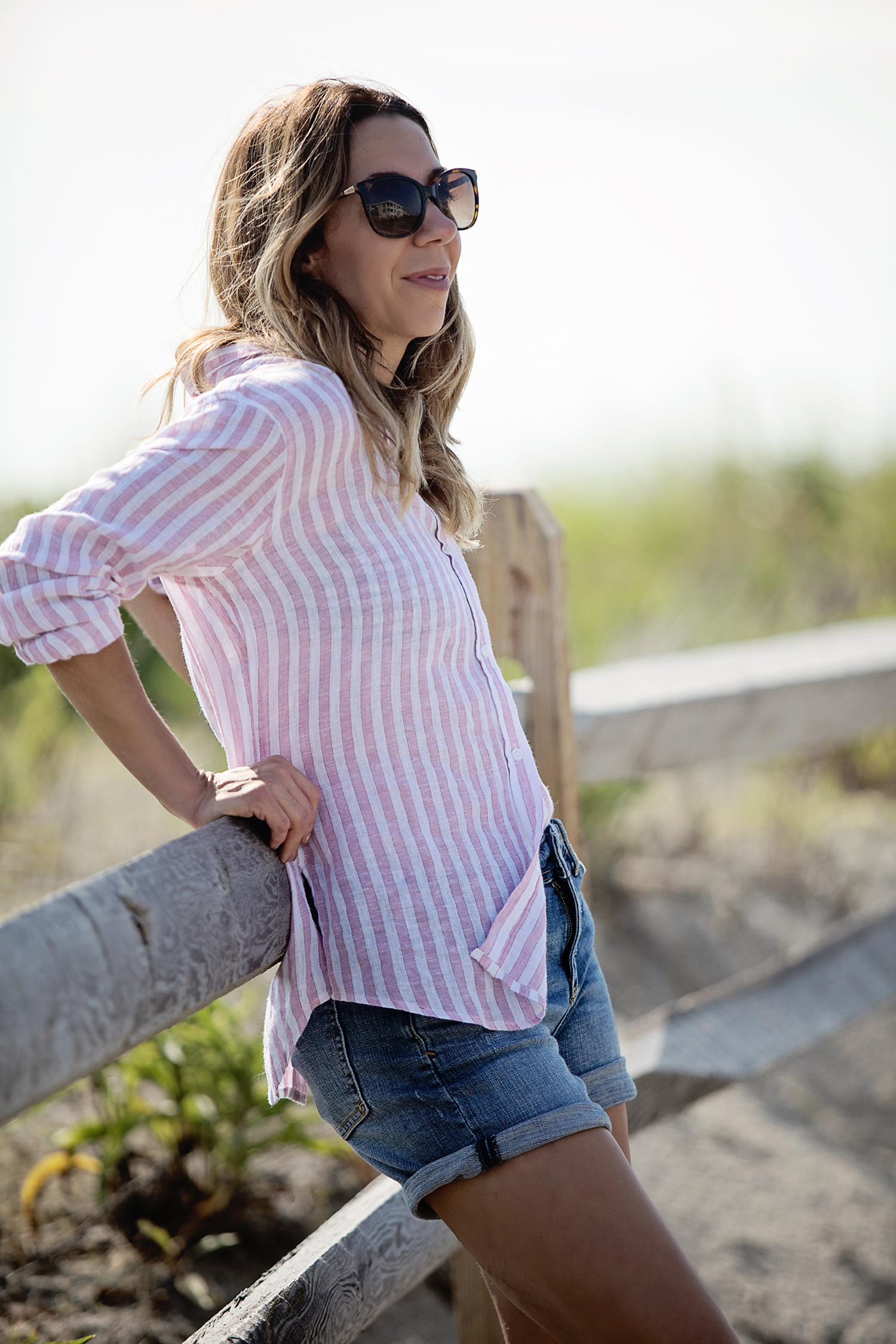 The Motherchic wearing rails button-down