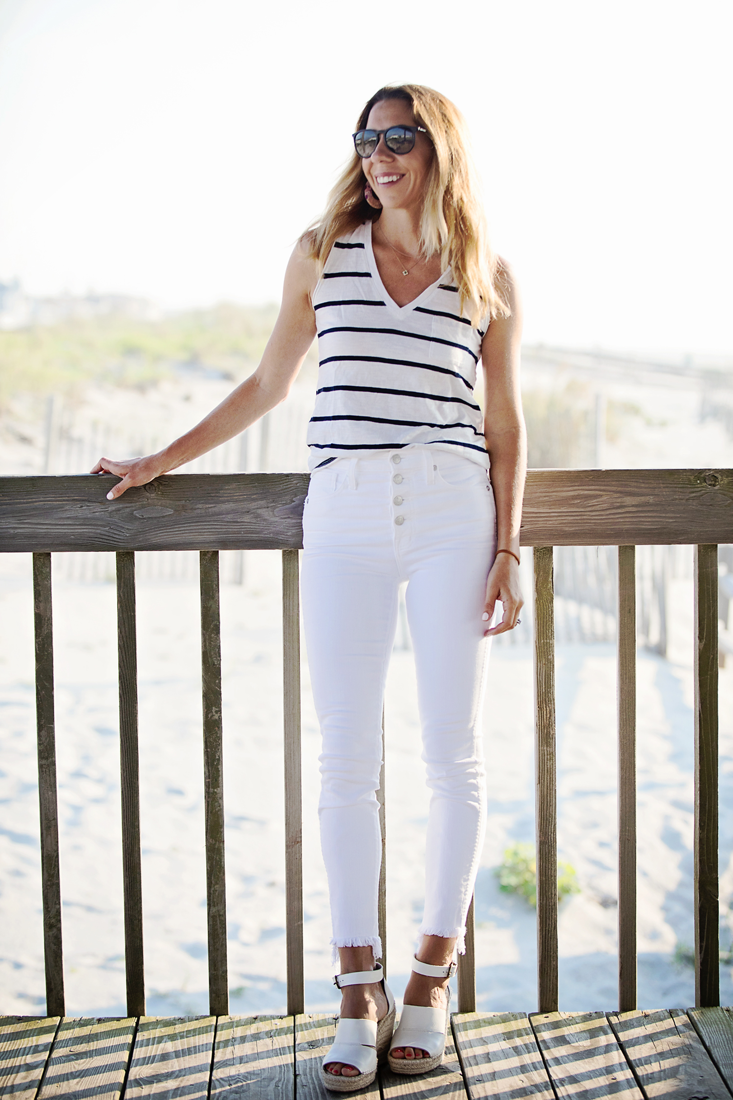 The motherchic wearing madewell jeans and whisper tank