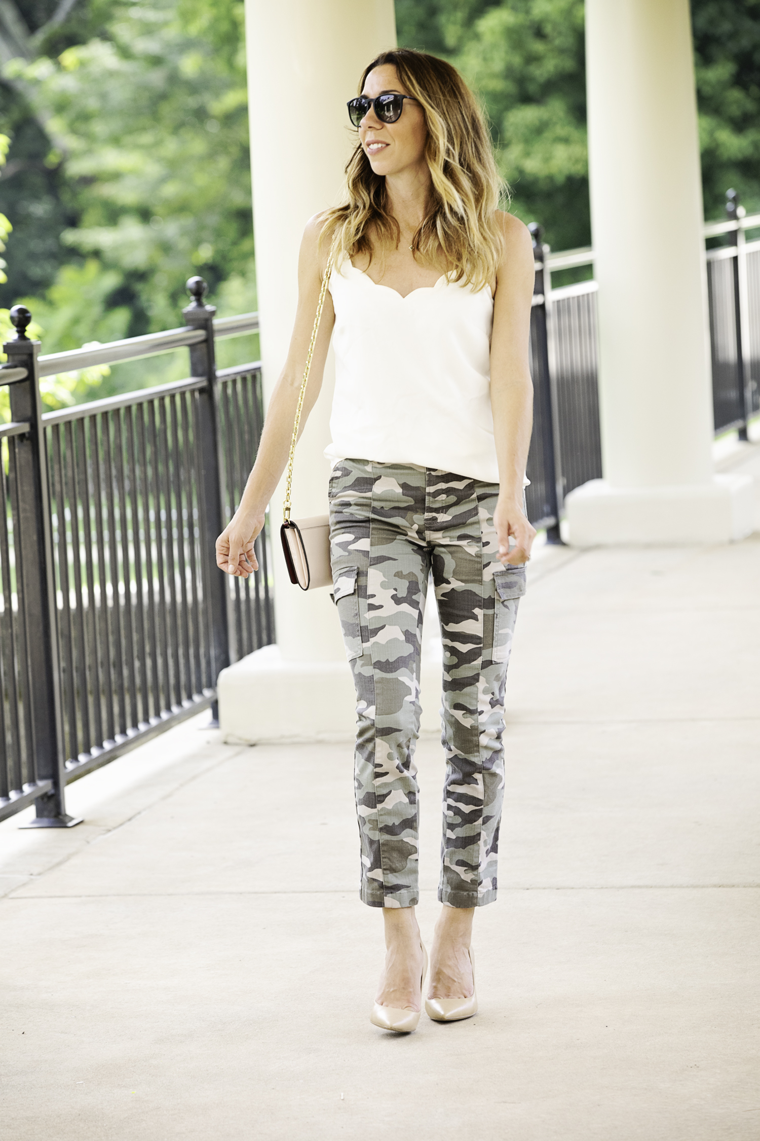 the motherchic wearing camo pants and scalloped camisole