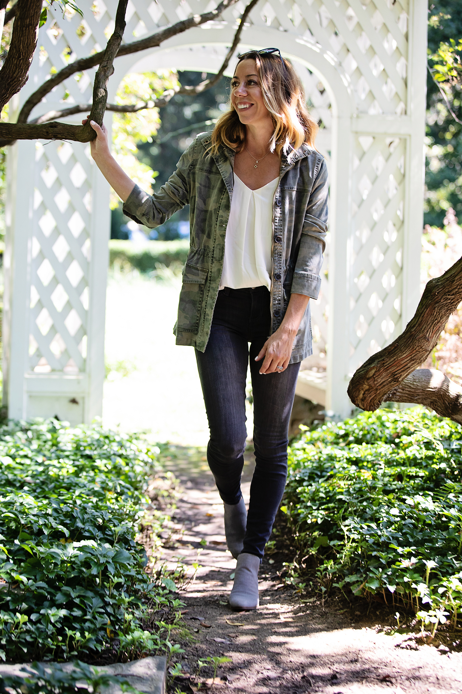 The Motherchic wearing camo utility jacket