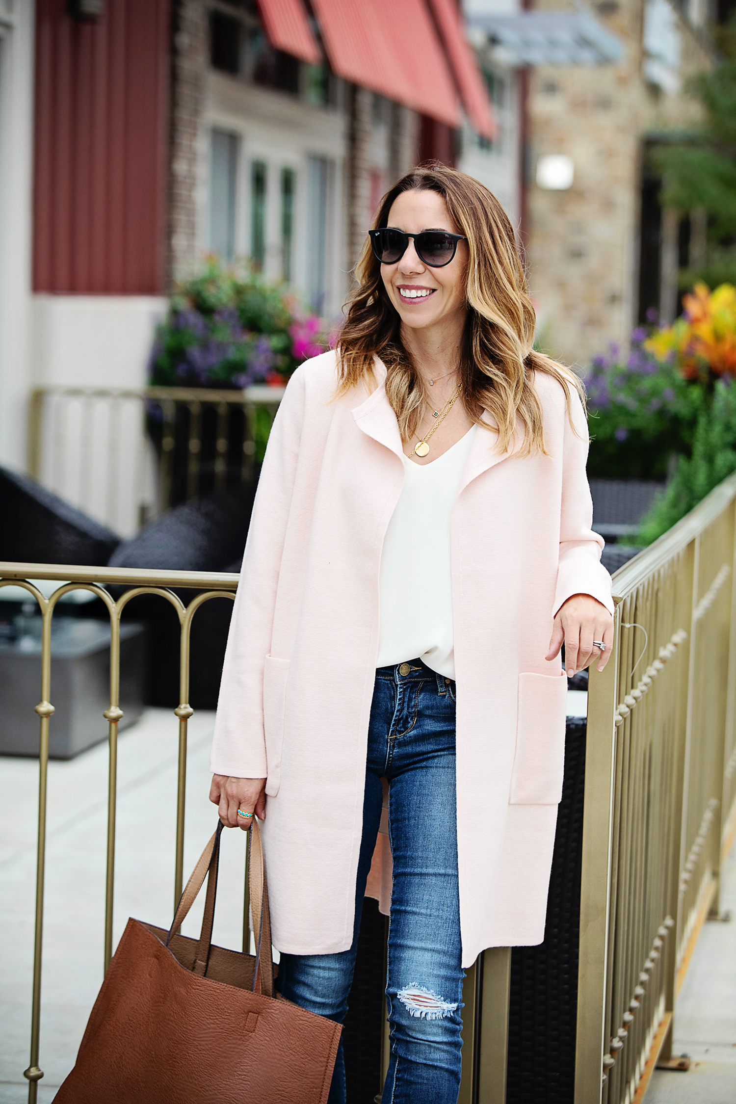 the motherchic wearing jcrew cardigan jeans reversible tote and raybans