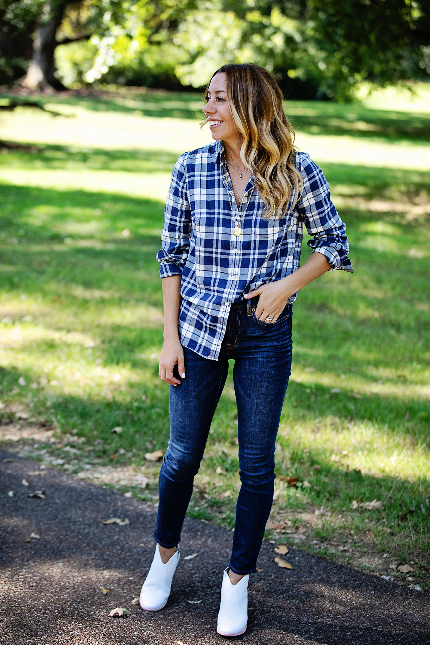 the motherchic wearing plaid jeans and booties