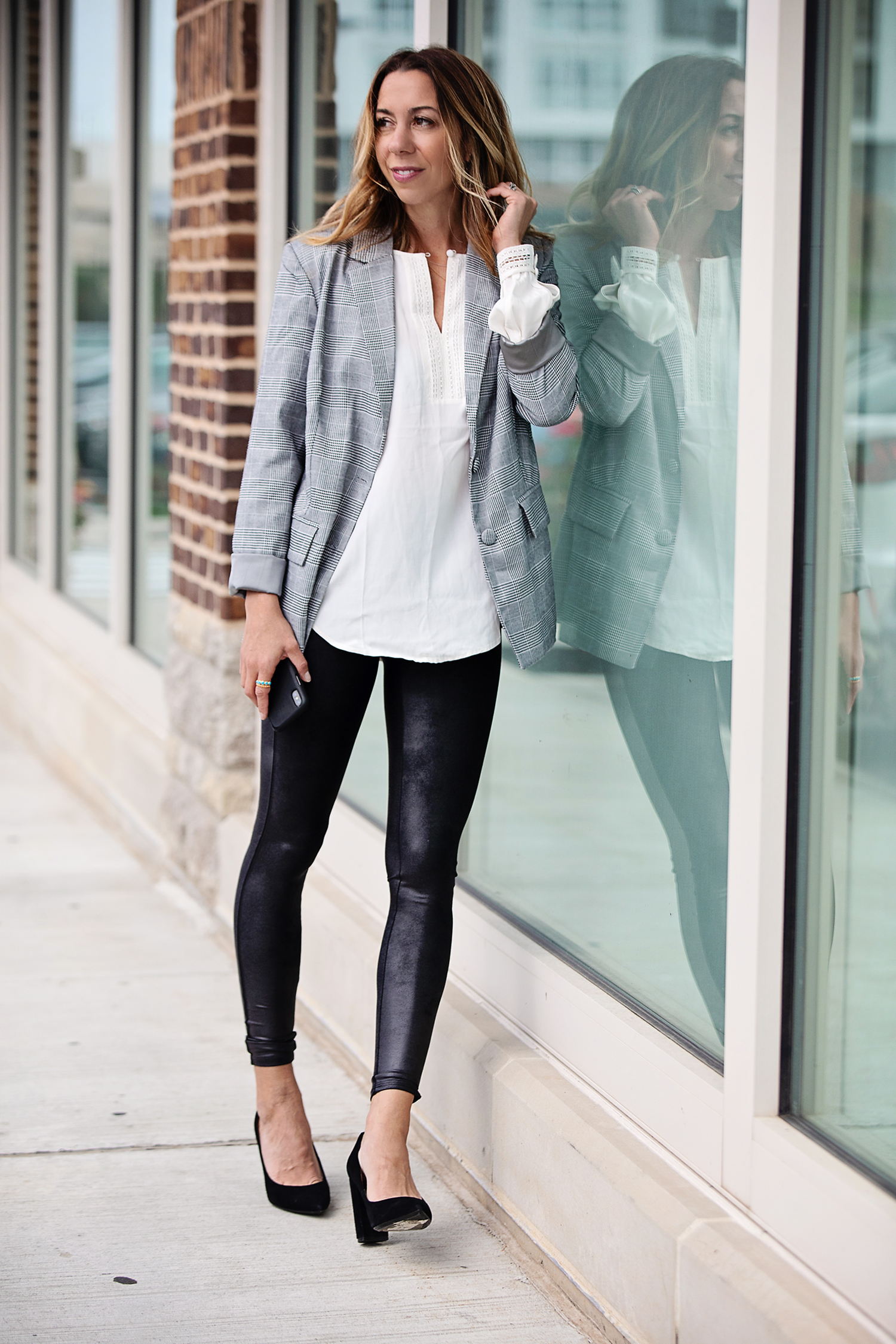 the motherchic wearing leather leggings blazer blouse and black heels