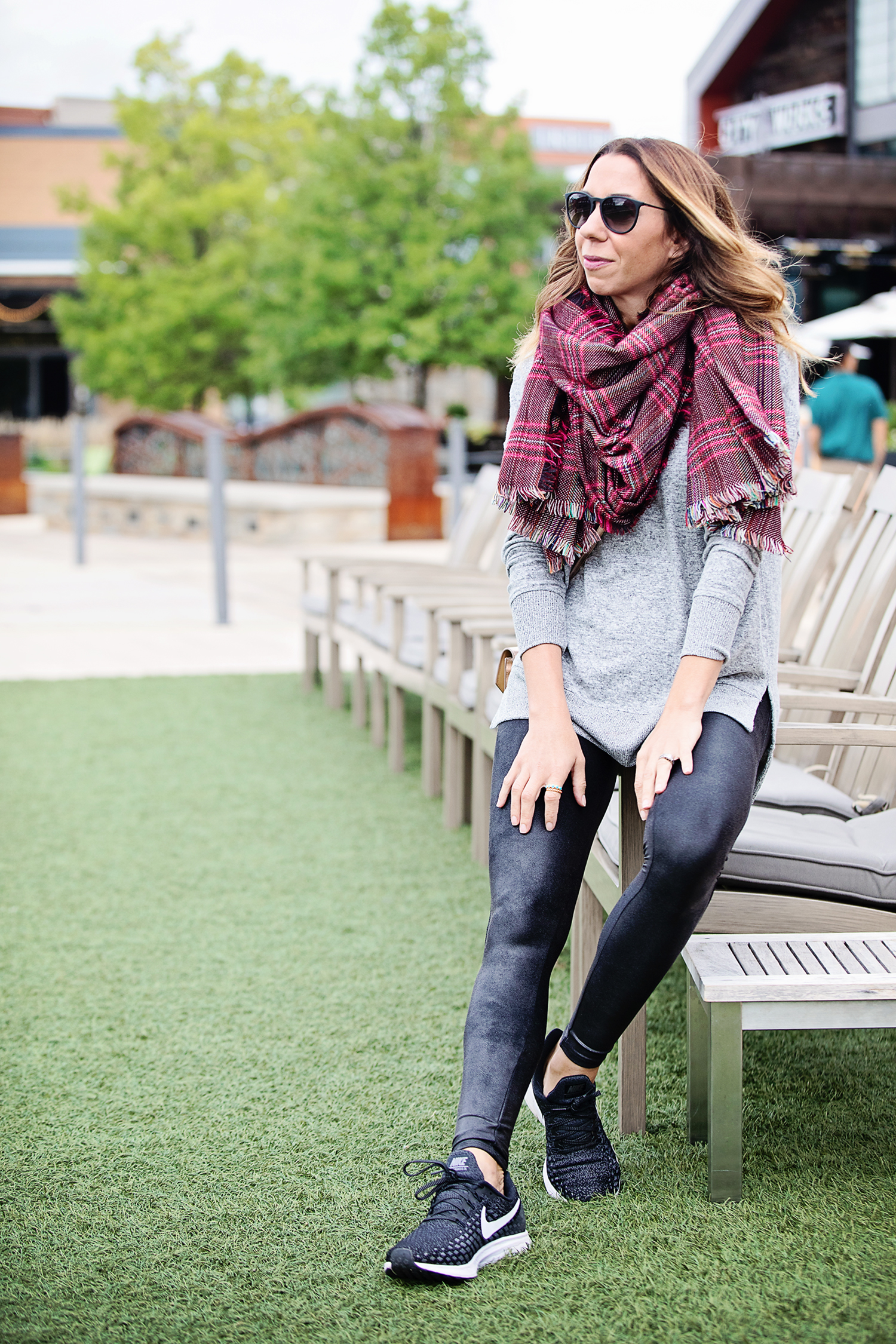 the motherchic wearing leather leggings comfy pullover and scarf