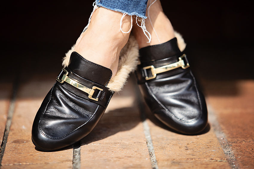 The Motherchic wearing steve madden mules