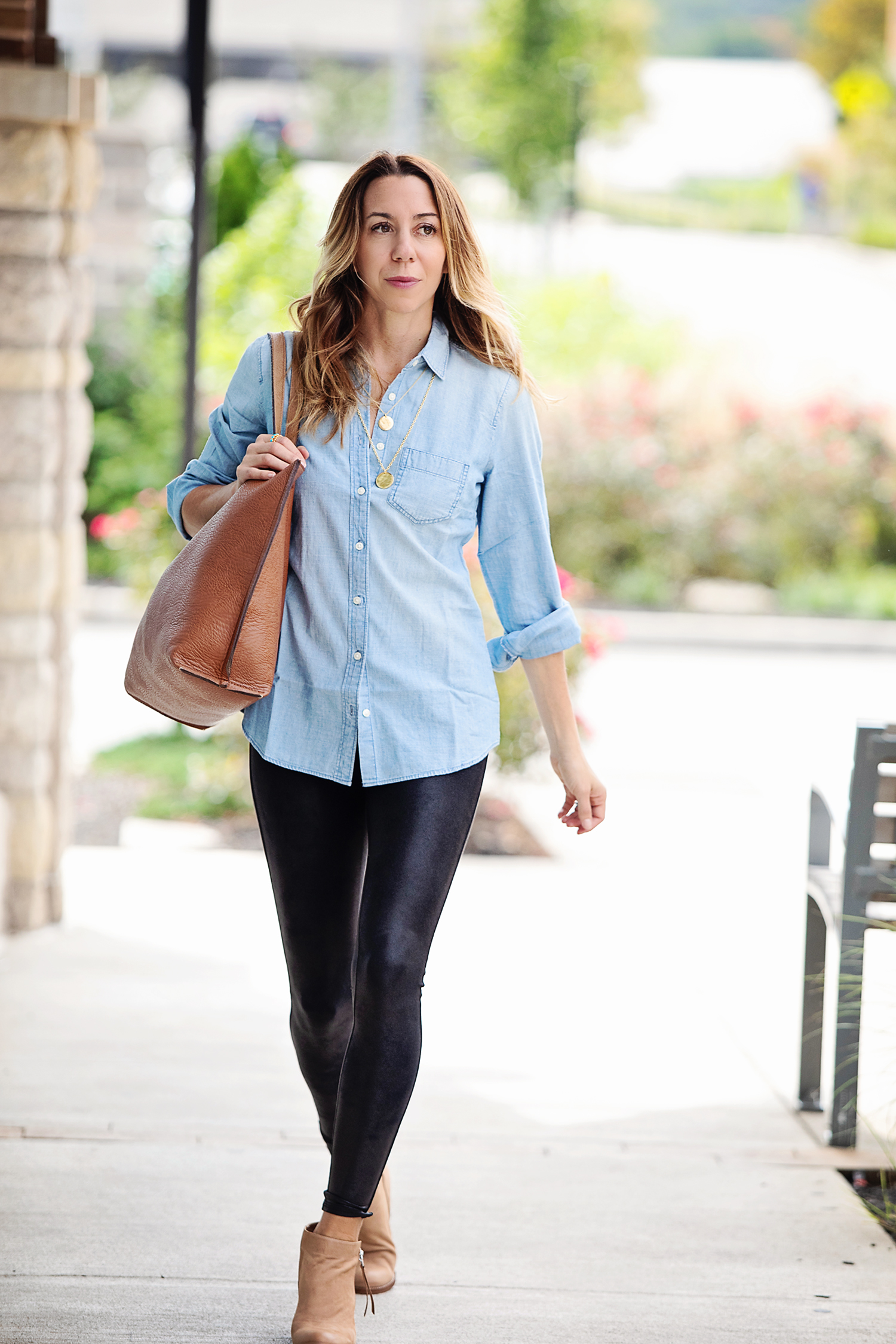 the motherchic wearing leather leggings chambray and cardigan