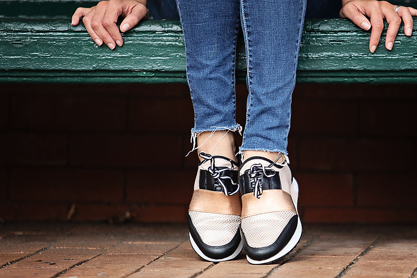 The motherchic wearing steve madden sneakers from Macy's