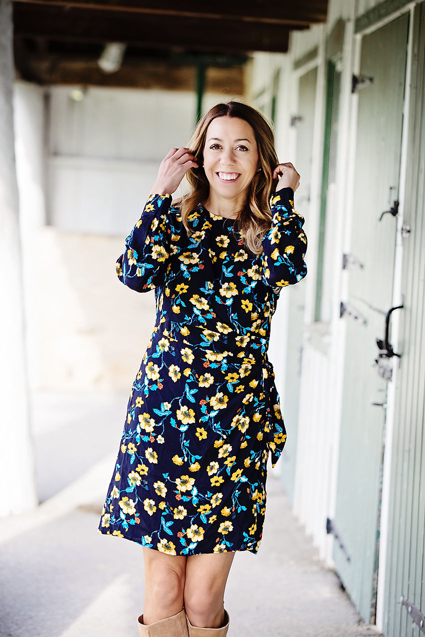 The Motherchic wearing floral long sleeve dress from Nordstrom