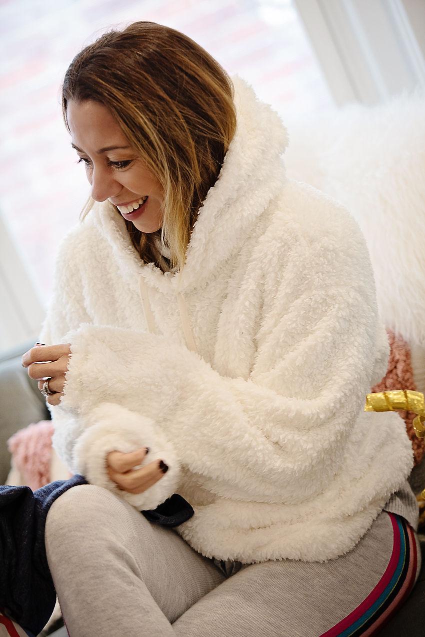 the motherchic wearing gap sweatshirt white fuzzy