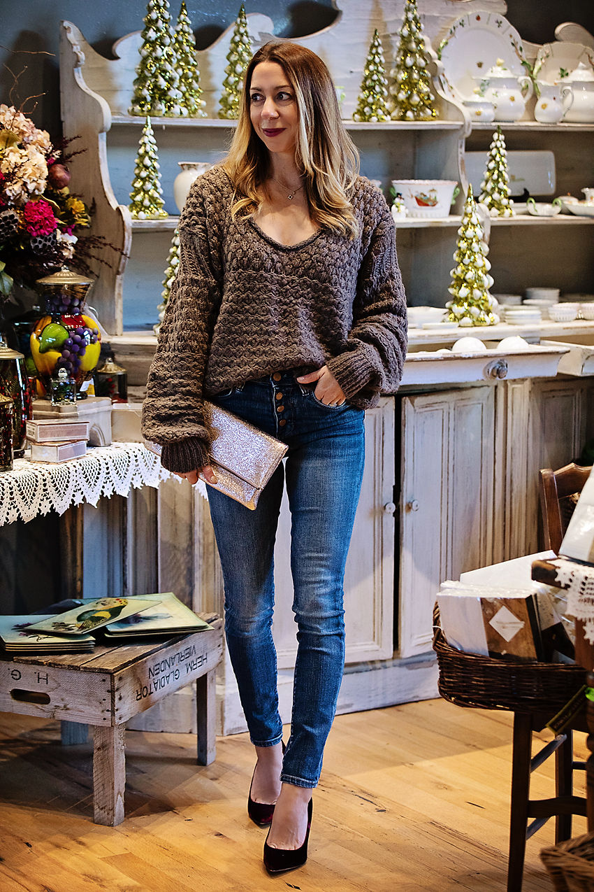 The Motherchic wearing thanksgiving outfit, free people sweater