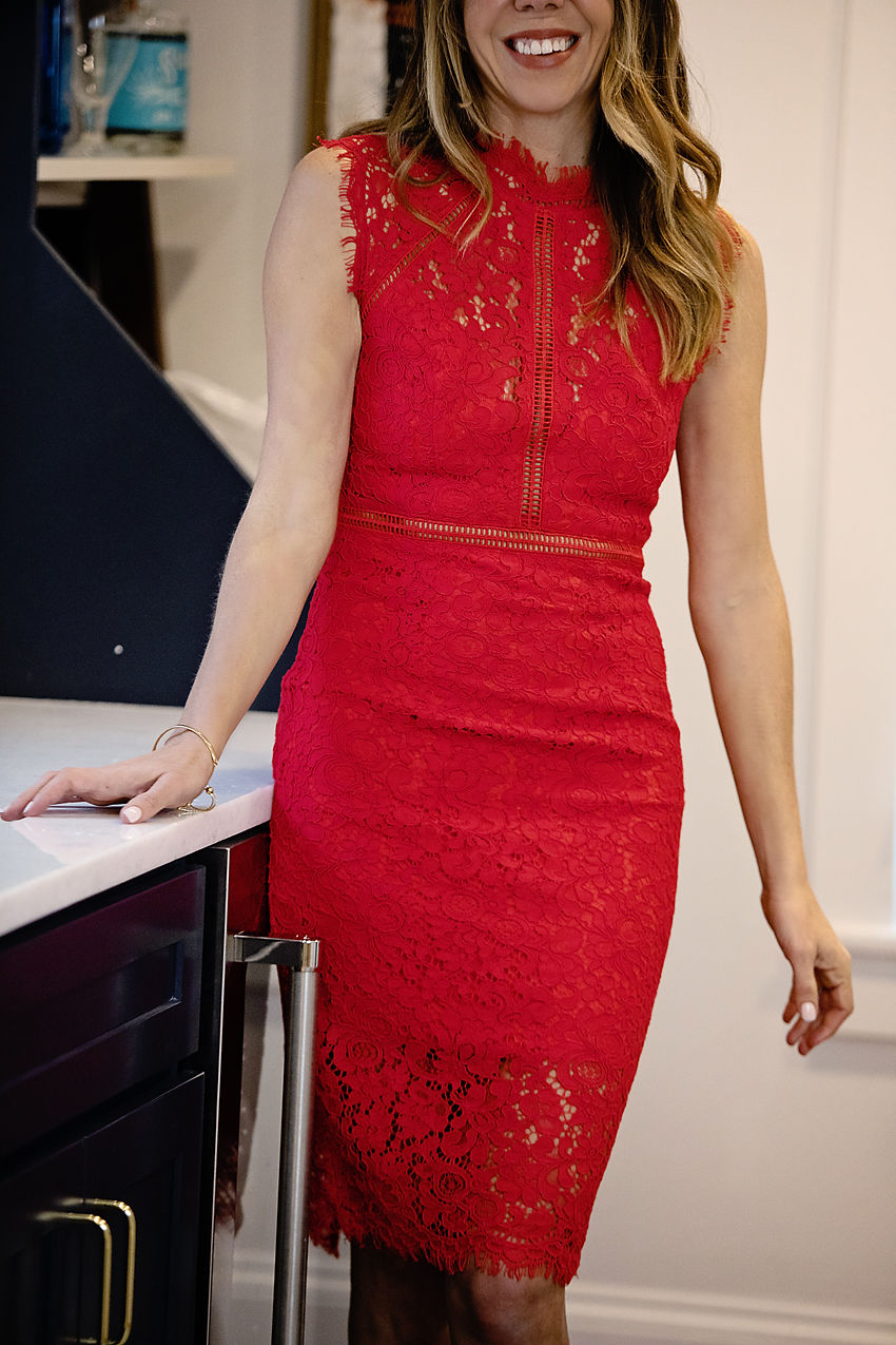 The Motherchic wearing red bardot dress