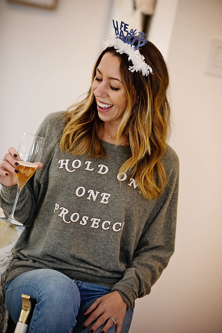 The Motherchic wearing Prosecco sweatshirt New Years eve outfit