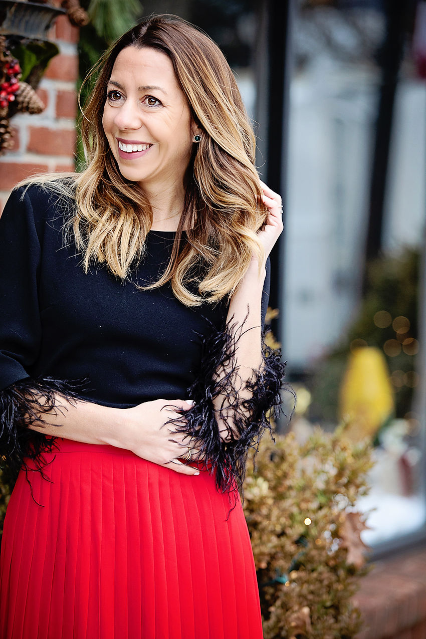 the motherchic wearing ann taylor feather top pleated skirt