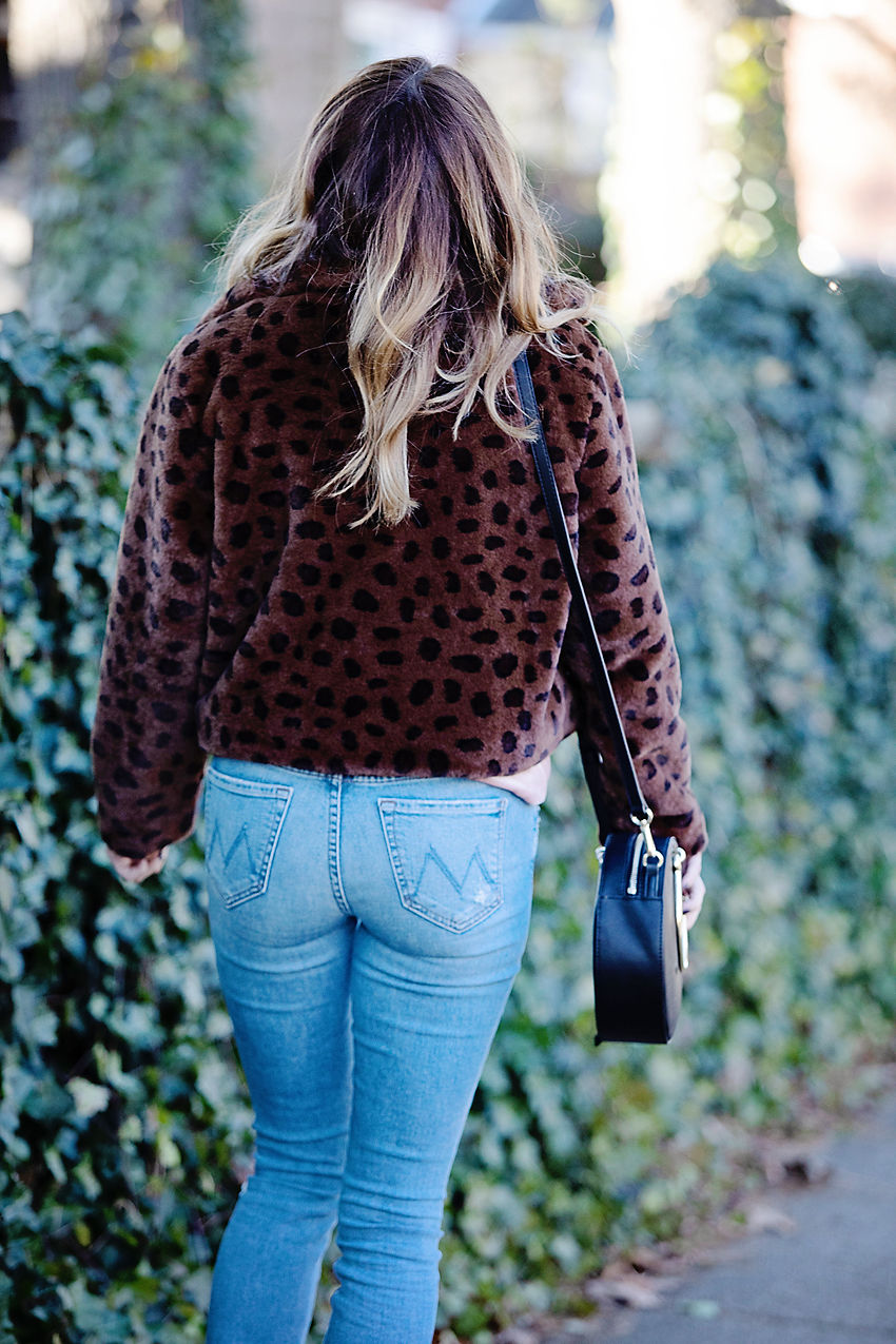 The Motherchic wearing faux fur leopard coat as New Years eve outfit idea