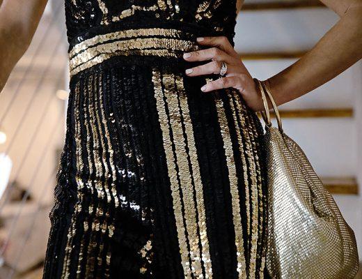 The Motherchic wearing sequin jumpsuit