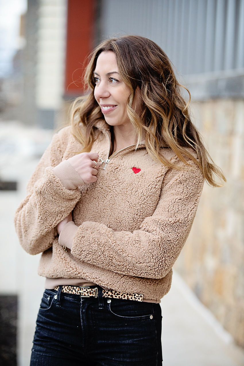 The Motherchic wearing topshop fleece with embroidered heart