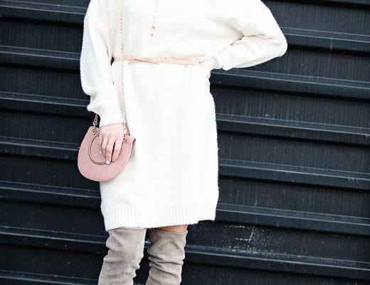 The Motherchic wearing winter date night outfit sweater dress