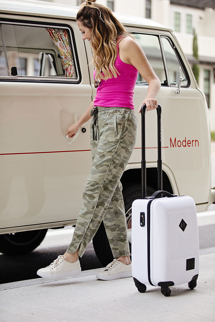 The Motherchic wearing Camo joggers from nordstrom
