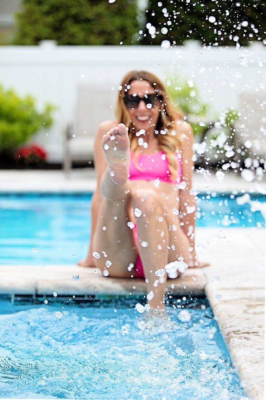 The motherchic wearing Athleta bikini and swim shorts