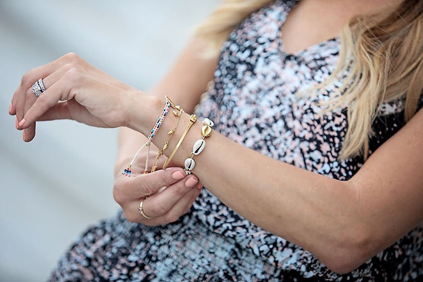 The Motherchic wearing madewell bracelets