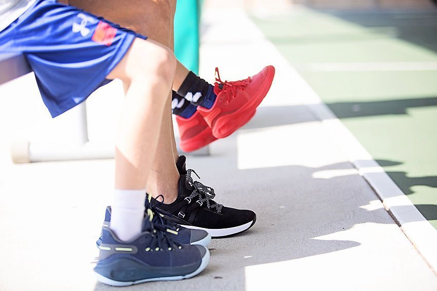 The Motherchic wearing Under Armour sneakers