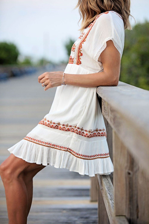 The motherchic wearing free people mini dress