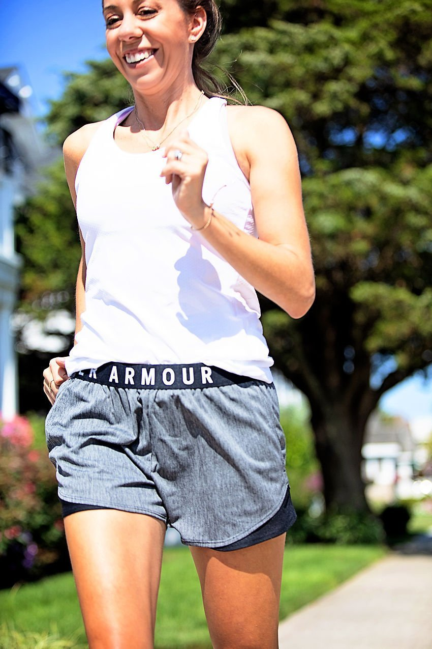 The Motherchic wearing Under Armour shorts