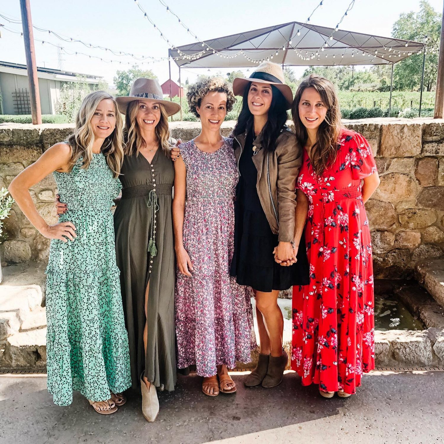 The motherchic wearing maxi dress in wine country