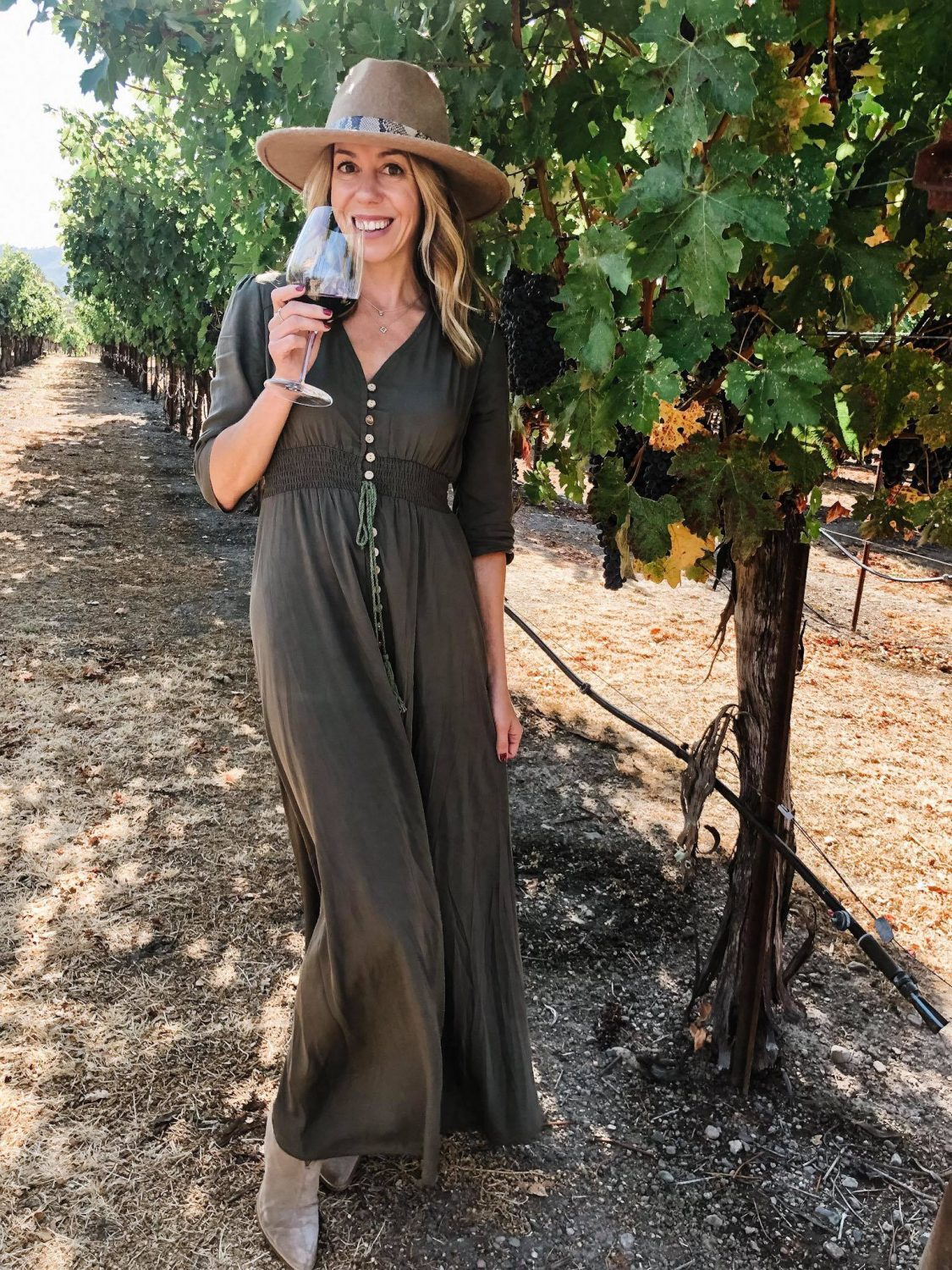 The motherchic wearing a maxi dress in wine country