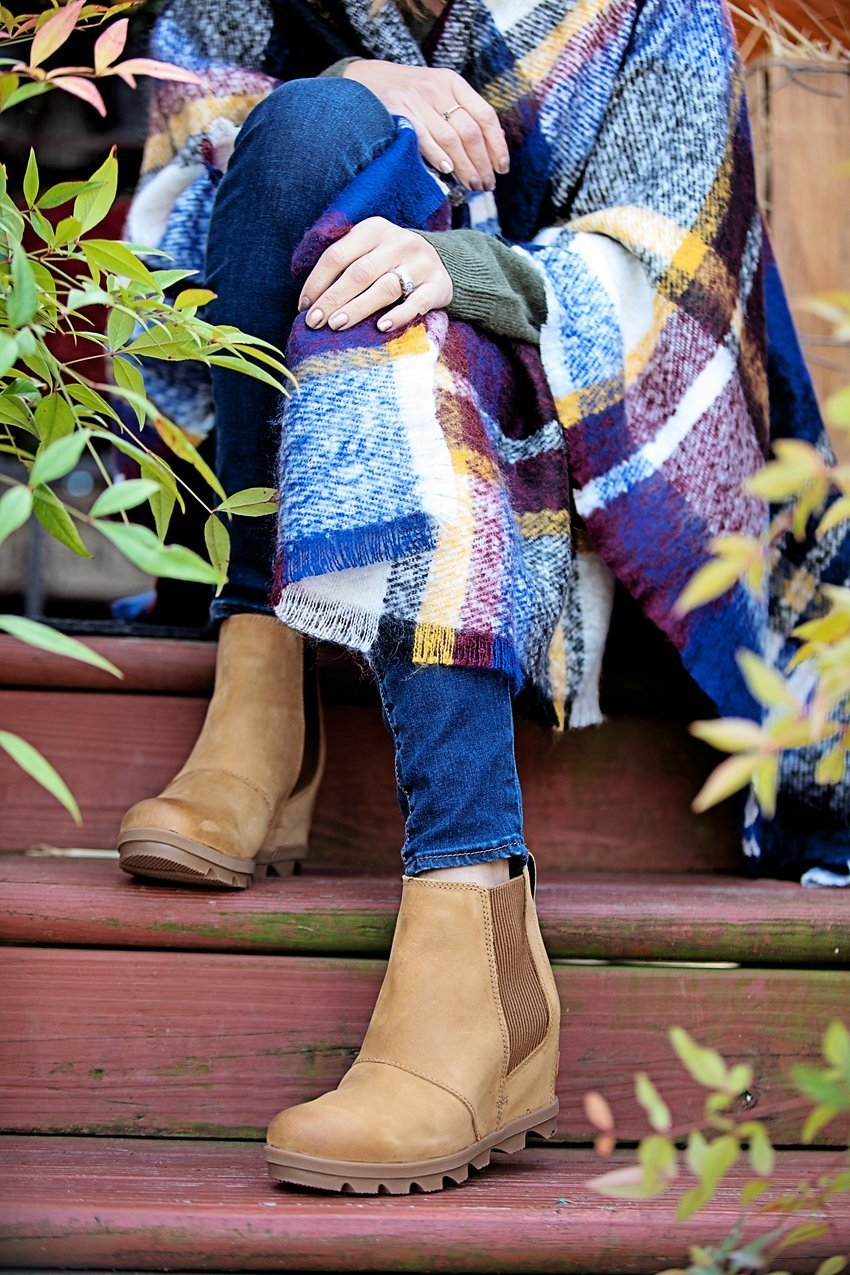 The Motherchic wearing Sorel boots, a cozy gift idea