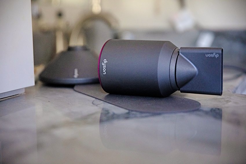 The Motherchic using Dyson hair dryer