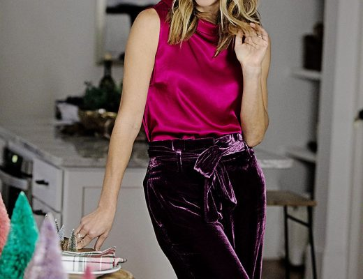 the motherchic wearing boden velvet pants gold booties pink top