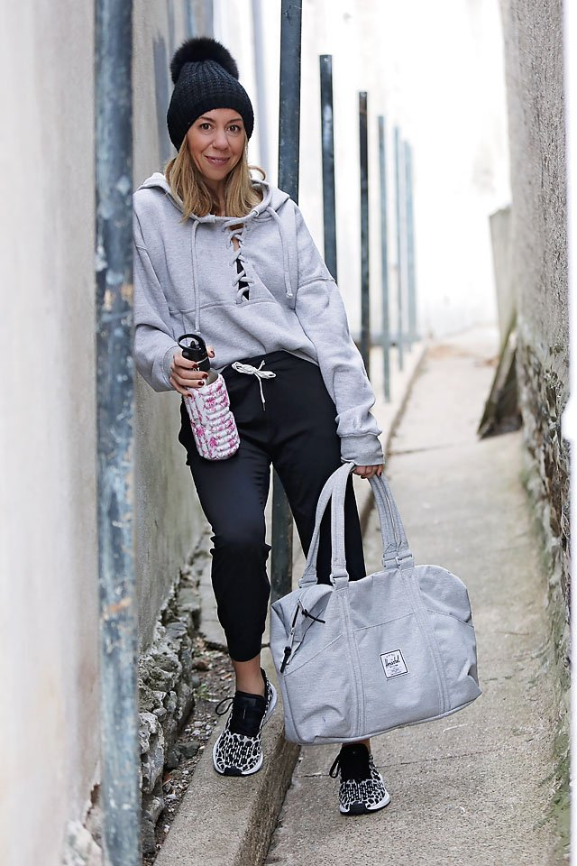 The Motherchic wearing joggers and lace up hoodie from Nordstrom