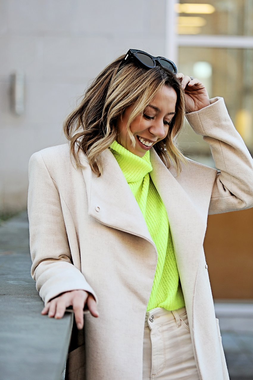 the motherchic wearing neon yellow sweater macys