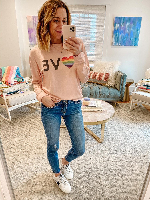 the motherchic wearing love sweatshirt jeans vintage havana sneakers