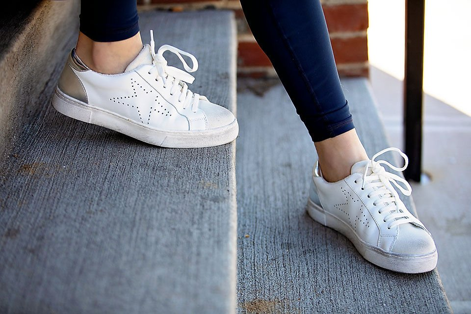 the motherchic wearing steve madden fashion sneakers