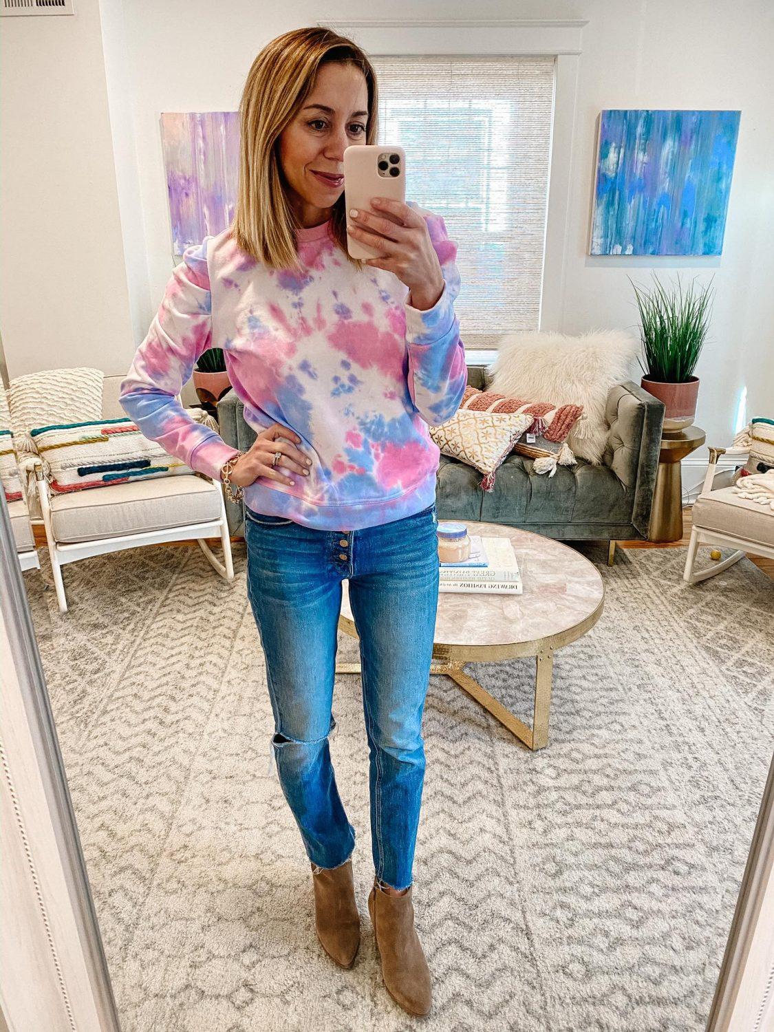 the motherchic wearing tie dye top button fly jeans booties