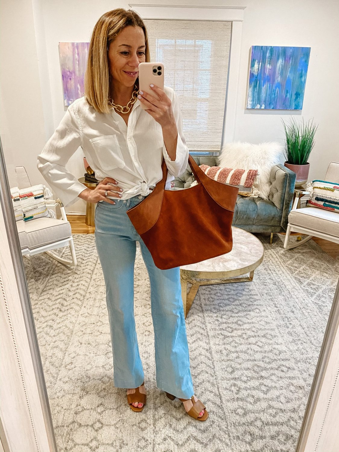 the motherchic wearing everlane jeans white top sole society bag