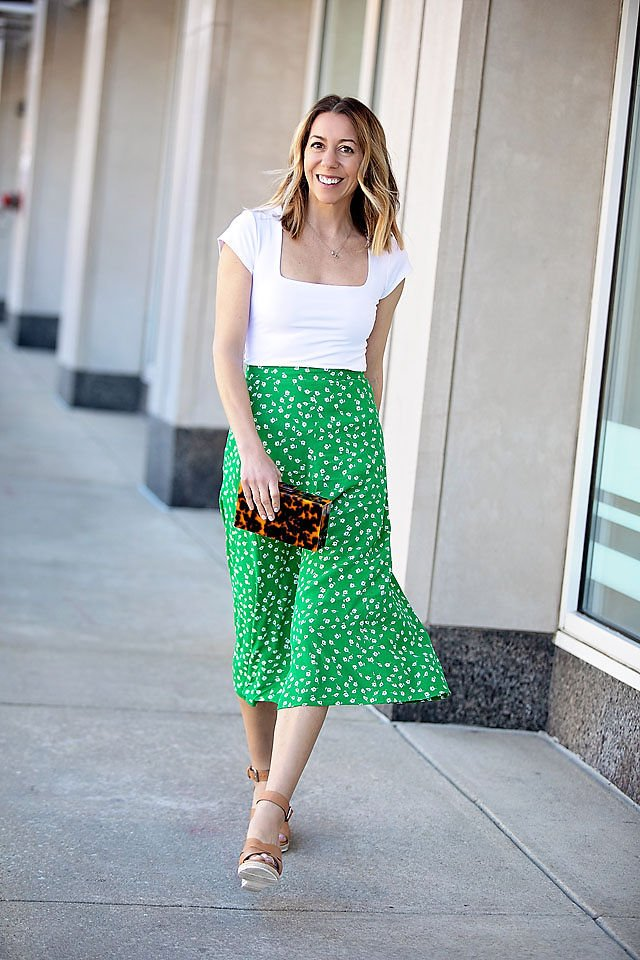 the motherchic wearing h&m skirt bodysuit jcrew jacket clutch and wedges