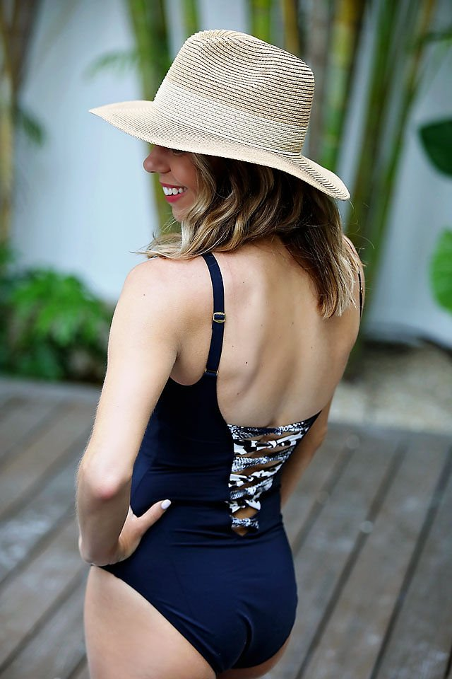 the motherchic wearing lace up swimsuit