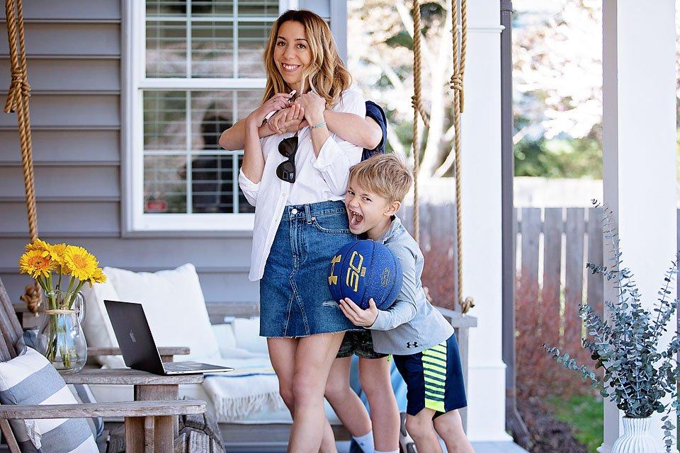 The Motherchic wearing Everlane air shirt and denim skirt