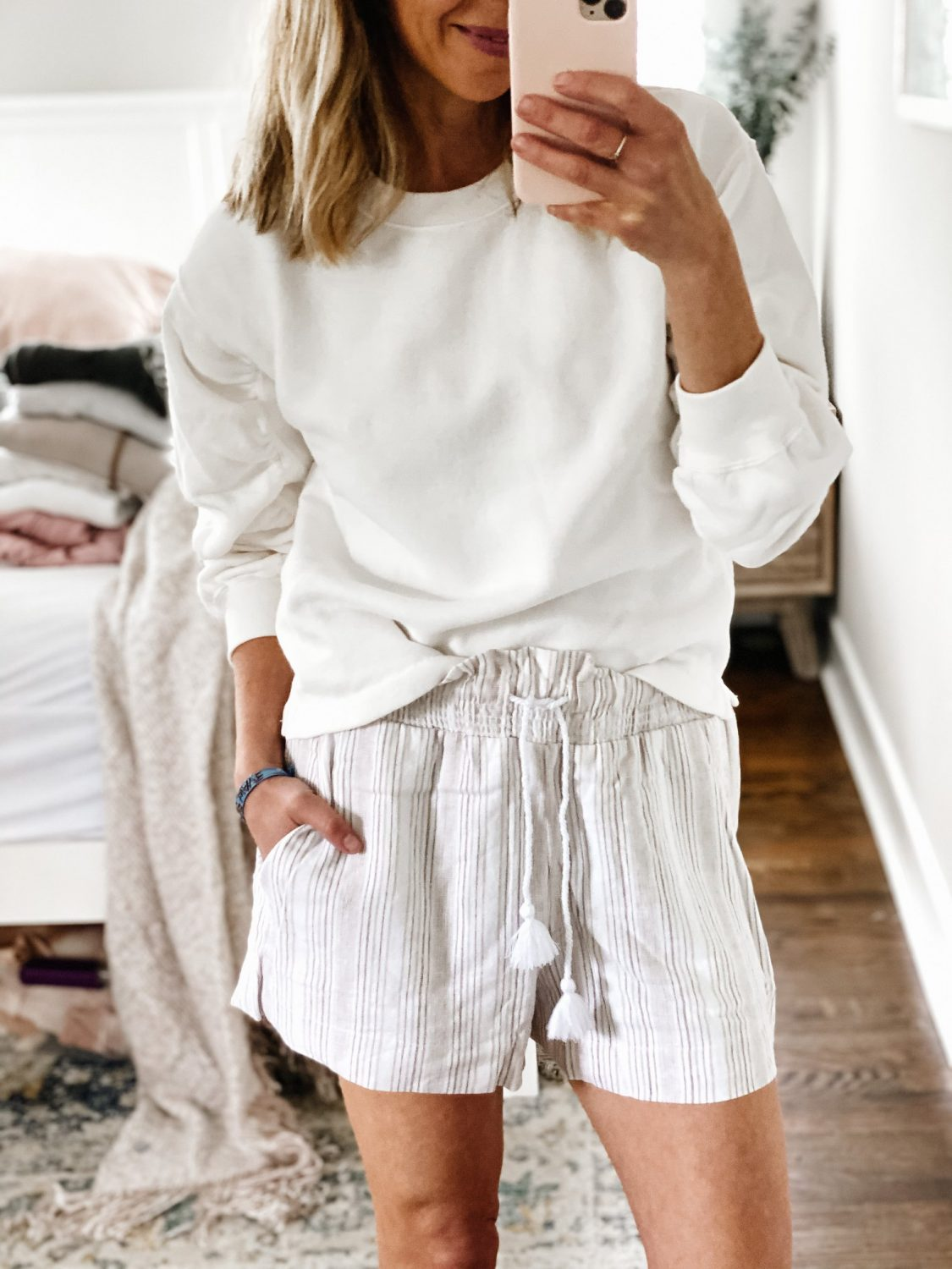 the motherchic wearing abercrombrie shorts and sweatshirt