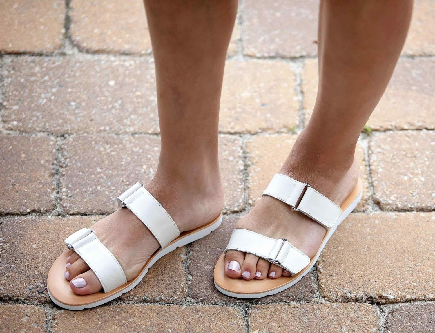 the motherchic wearing white sandals