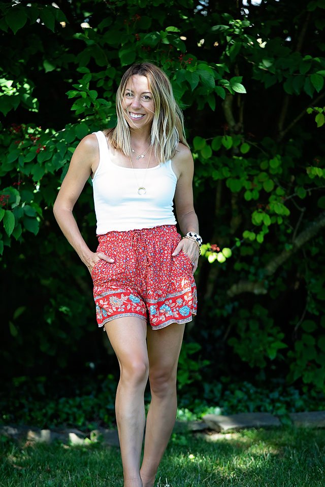 The Motherchic wearing pull-on shorts from amazon