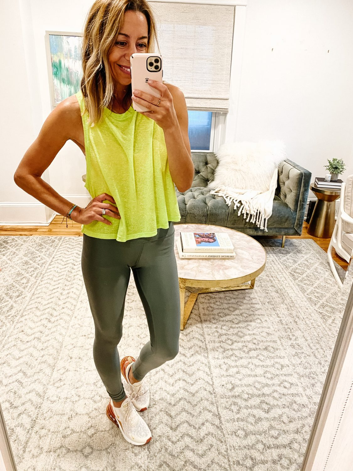 the motherchic wearing nike sneakers alo legging sweaty betty top