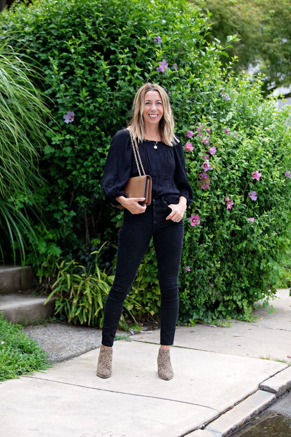 the motherchic wearing madewell black jeans tory burch bag dolce vita booties