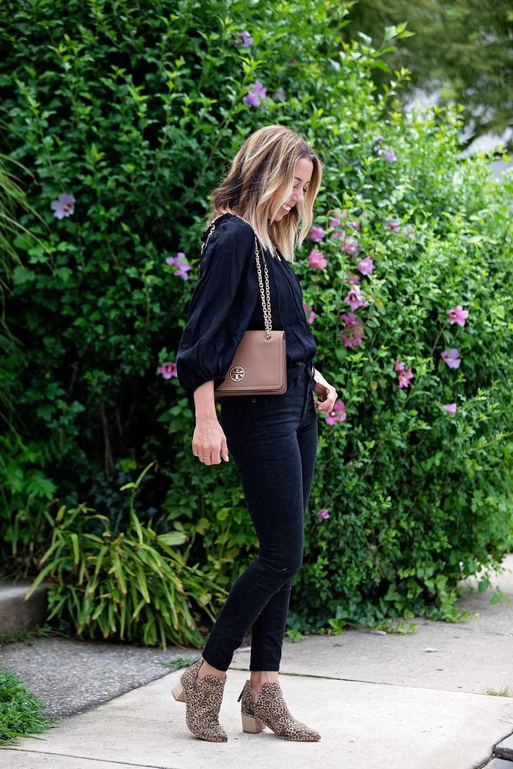 the motherchic wearing madewell black jeans all in favor top